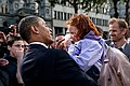 Barack Obama holds a young girl in Dublin.jpg