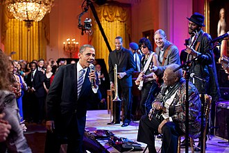 "President Obama and King singing ""Sweet Home Chicago"" on February 21, 2012 Barack Obama singing in the East Room.jpg"