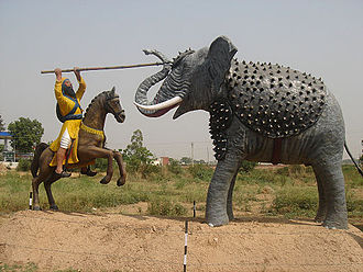 Second Battle of Anandpur - A depiction of Bhai Bachitter Singh killing the drunk elephant set by Mughal forces on the Sikh forces in the battlefield with Nagni Barcha (snake spear) given by Guru Gobind Singh Ji. This photo was taken by outside the Sikh History museum on way from Mohali to Sirhind
