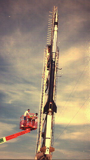 MSSTA - Sounding rocket 36.049, carrying the MSSTA (silvery section at top), on the launch rail at White Sands Missile Range, May 1991.  The personnel aboard the crane have just installed an arming plug into the payload to prepare it for launch.