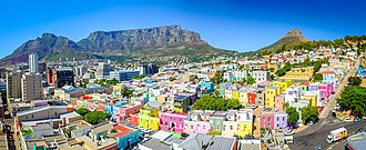 Bo-Kaap - Bo-Kaap area of Cape Town with its distinctive pastel coloured houses in the foreground with the city centre to the left and Table Mountain in the background.