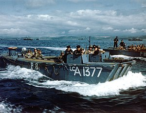 Landing Craft Assault - Royal Navy Landing Craft LCA-1377 carries American troops to a ship in a British port, during preparations for the Normandy invasion, circa May–June 1944.