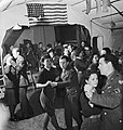 British Land Army girls and members of the Women's Royal Air Force (WAAF) dance with men of the US Eighth Army Air Force in Suffolk during 1943. D14124.jpg