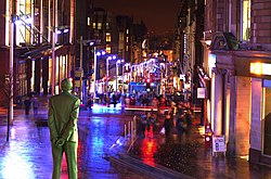 Buchanan Street at night, looking southward behind the Donald Dewar statue.
