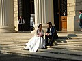 Bucharest, Romania. Bride couple in a relaxation moment on the steps of Romanian Athenaeum.jpg