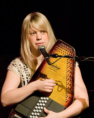 Basia Bulat plays guitar, autoharp, and hammer...