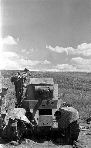 Battle of Brody (1941) - German soldiers examining an abandoned Soviet BT-7 tank