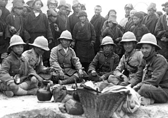 Tibetan Army - 1938 new year's military parade, army officers enjoying a break for  Tibetan salted-butter tea