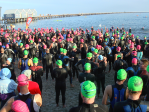 Picture is presenting triathletes gathering on...