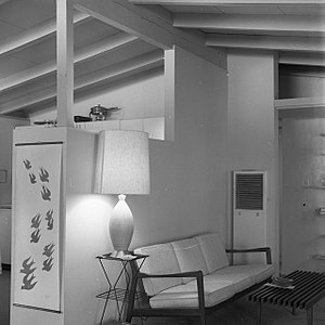 Living room - A California tract home living room, with a kitchen behind a permanent space divider, 1960