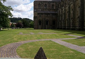 Old Minster, Winchester - Modern tiles outline the site of the minster next to Winchester Cathedral
