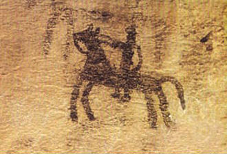 Prehistoric cave painting, depicting a horse and rider Cave painting in Doushe cave, Lorstan, Iran, 8th millennium BC.JPG