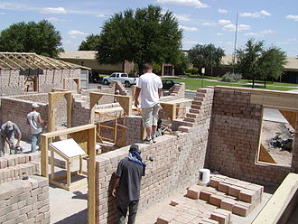 Compressed earth block - Building a CEB project in Midland, Texas in August 2006