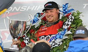 Chad Hord - Hord holding his 2011 AMSOIL Cup
