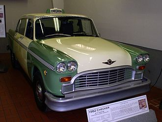 Checker Taxi - The last Checker Taxicab built, 1982 A11 in green and cream with Checker's trademark checkerboard trim on display at the Gilmore Car Museum in Kalamazoo