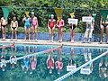 Child swimmers in a line at a swim meet 2.jpg