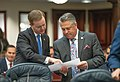 Clay Yarborough and Chip LaMarca confer on the House floor.jpg