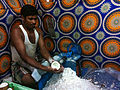 Coconut being grated.jpg