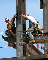 ironworkers erecting the steel frame of a new building at the massachusetts general hospital in the united states