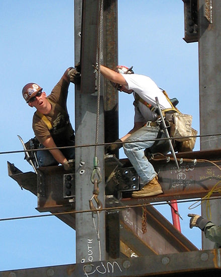 Ironworkers erecting the steel frame of a new building at Massachusetts General Hospital in Boston Construction Workers.jpg