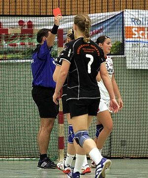Penalty card - A red card shown in a handball match