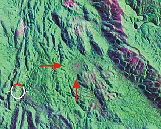 Darwin Crater - False-colour Landsat image of Darwin Crater (arrowed); screen capture from NASA World Wind