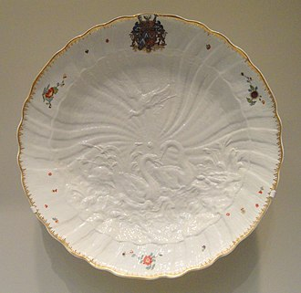 Plate (dishware) - Plate with a lip and central well, also with relief and painted decoration, including a gilded rim, from the Swan Service, Meissen porcelain, c. 1740