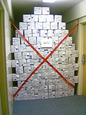 Wall of 100 USPS Priority Mail boxes blocking ...