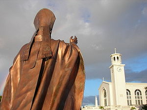 Dulce Nombre de Maria Cathedral Basilica in Hagatna, faced by a statue of Pope John Paul II. Roman Catholicism is the main religion in Guam.