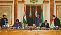 E. Ahammed and the DPM and Minister for Hydrocarbons, Mr. Tachberdy Tagyev signing the agreement in presence of the Vice President, Mohammad Hamid Ansari and the President of Turkmenistan, Mr. Gurbanguly Berdumuhamedov.jpg