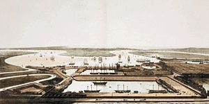 East India Docks - East India dock looking south towards the River Thames, 1806. The original Brunswick dock and mast house can be seen alongside the river.