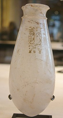 A small glass vase with the cartouches of Rudamun