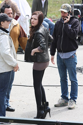 Actress Emily Meade (center) appeared in the finale as a grown-up version of Ella Dunham, now a rookie FBI agent. Emily Meade filming Twelve in Central Park, 21-04-09.jpg