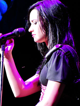 """Don't Forget (song) - Lovato performing """"Don't Forget"""" during the Summer Tour 2009"""