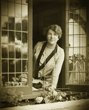Ethel Turner - Cazneaux's portrait of Ethel Turner posing in the window of her study at her Mosman home, 'Avenel', 1928