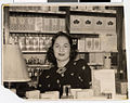 Etheldoris Grais at the fragrance counter of the cosmetic department at Stein Rexall Drug Store, Hibbing.jpg