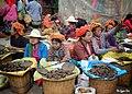 Ethnic women selling fermented soybeans on market day (January 2020).jpg