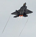 F-22 Raptor climbing after a high speed pass (5232749964).jpg