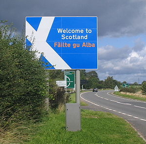 A7 road (Great Britain) - Scotland welcomes arrivals on the A7 with a bilingual sign including Fàilte gu Alba