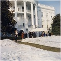 First Lady and Daughter depart White House for Glen Ora. President Kennedy, holding Caroline Kennedy, First Lady... - NARA - 194195.tif