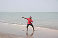 Fisherman who casts his line into the sea the Gambia.jpg