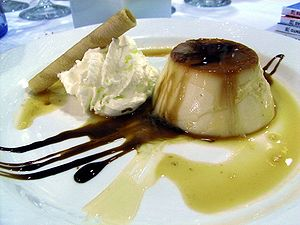 Crème caramel - Restaurant-prepared order of crème caramel with sauce and garnish