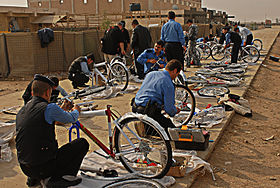 Flickr - The U.S. Army - Hitting the streets of Iraq on two wheels.jpg
