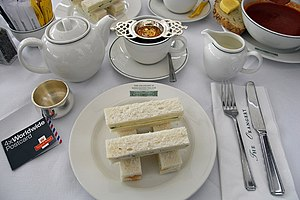 Cucumber and cream cheese sandwiches with tea ...