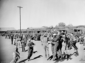 Australian rules football during the World Wars - Australian soldiers, sailors, and airmen take part in an impromptu game of end-to-end Australian rules football in Central Australia in 1944.