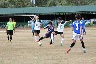 Football in the Philippines - Filipino youths playing football at the Baguio Athletic Bowl.