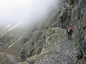 A picture of hikers along the Highline Trail i...