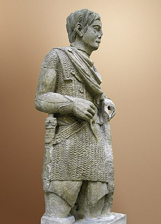 Chain mail - The Vachères warrior, 1st century BC, a statue depicting a Romanized Gaulish warrior wearing mail and a Celtic torc around his neck, wielding a Celtic-style shield.