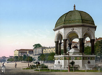 """German Fountain - Historic photochrom print. Note that the fountain is labelled Fontaine Guillaume, which literally translates to """"William (Wilhelm) Fountain""""."""