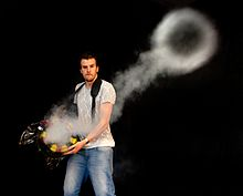 A demonstration of a smoke ring produced by a home-made vortex ring toy.